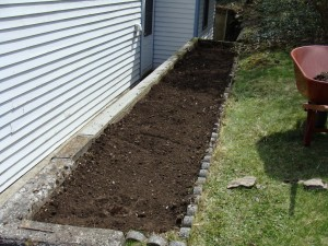 This planter area is going to be used for herbs and veggies.